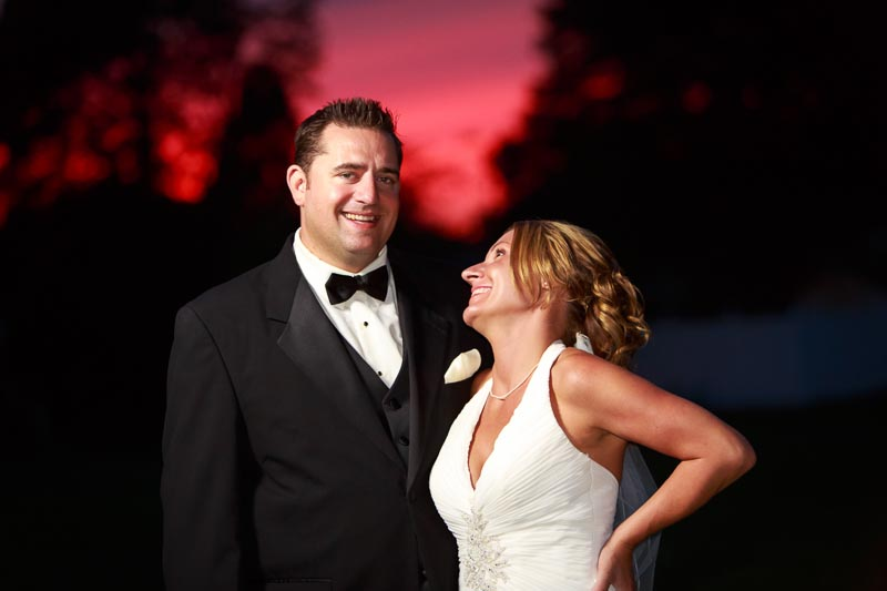 Outdoor sunset bride and groom portrait.