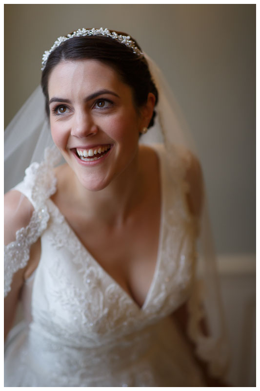 Happy bridal portrait beautiful window light in the stairwell at the Inn on Boltwood