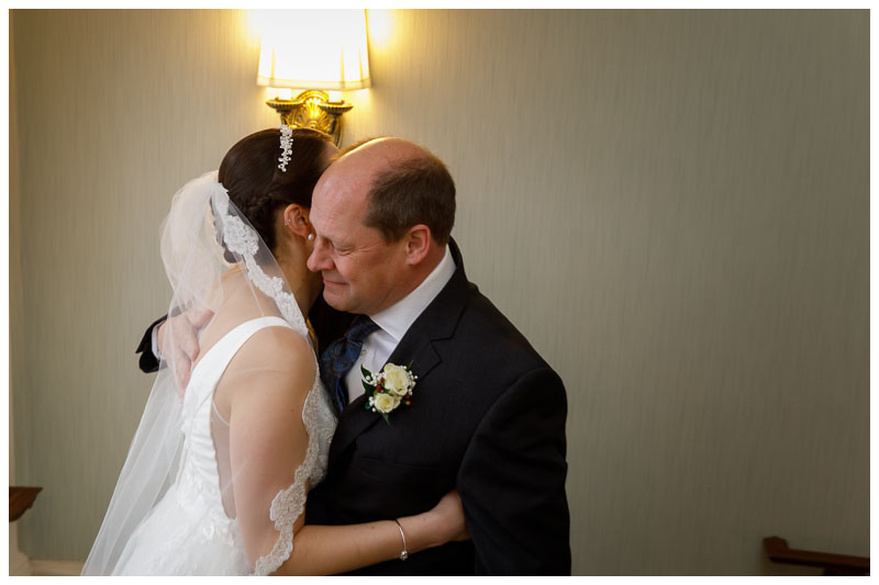 Father-daughter wedding moment.