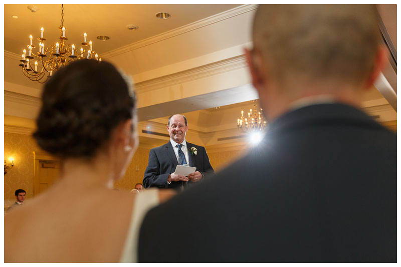 Father of the bride speech during the reception with bride and groom in foreground