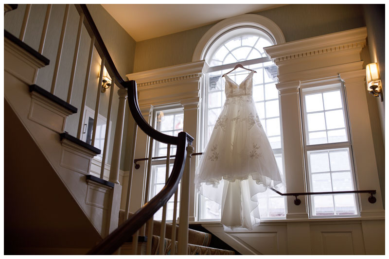 Gorgeous wedding dress hanging in the window of the Inn at Boltwood.